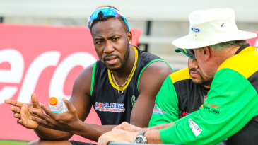 Jamaica Tallawahs captain Andre Russell chats with coaches Mark O'Donnell and Ramnaresh Sarwan during training