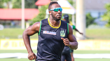 Andre Russell goes through his warm-up sprints during team training