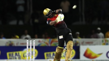 Dwayne Bravo clears the ball for take off