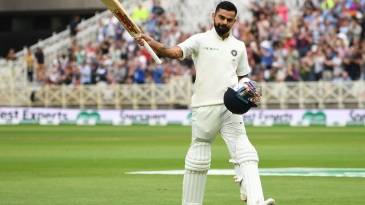 Virat Kohli walks off to a rousing reception