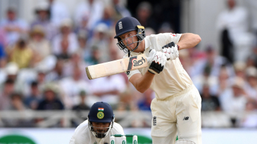 Jos Buttler steps out to drive through the off side