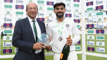 Virat Kohli accepts the man of the match award