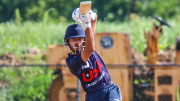 Monank Patel drives a straight six during an 80-ball century at USA selection trials