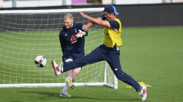 Collision course: Ben Stokes and Alastair Cook bump into each other during training