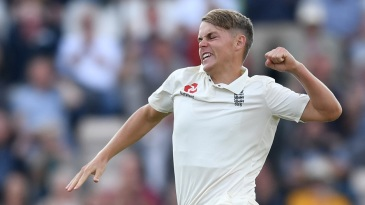 Sam Curran celebrates after claiming the precious wicket of Virat Kohli