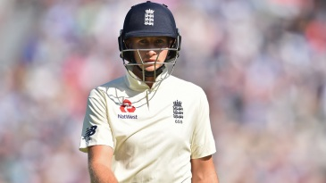 Joe Root walks back after being dismissed