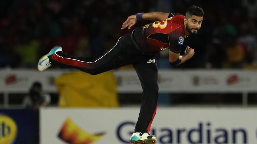 Ali Khan bowls