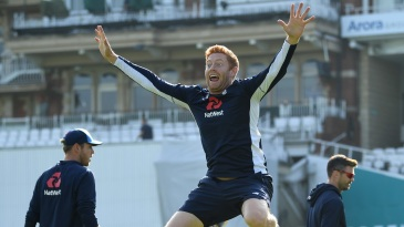 Jonny Bairstow leaps during a warm-up drill