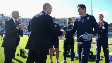 Alastair Cook receives a commemorative cap to mark his final Test appearance