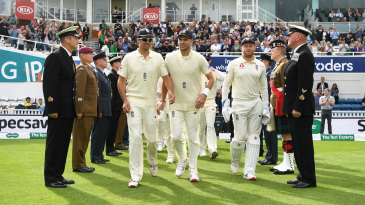Alastair Cook, James Anderson and Jonny Bairstow walk on to the field