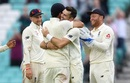 James Anderson is congratulated by his teammates for surpassing Glenn McGrath's tally of 563 Test wickets, England v India, 5th Test, The Oval, 5th day, September 11, 2018
