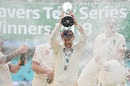 England uncork the champagne as Joe Root holds aloft the winner's trophy, England v India, 5th Test, The Oval, 5th day, September 11, 2018