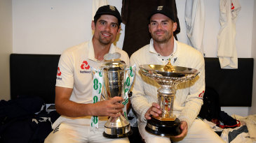 Alastair Cook and James Anderson pose with the series trophies after England's 4-1 win over India