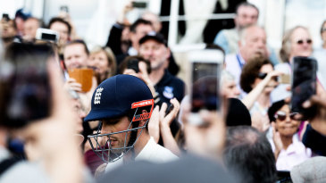 Spectators take photos of Alastair Cook on the camera phones