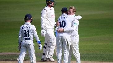 Simon Harmer gets a hug from Nick Browne