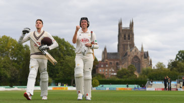 Morne Morkel and Rikki Clarke walk off after sealing the win that made Surrey champions