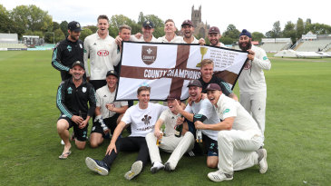 Surrey's players celebrate winning the Division One title