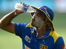 Lasith Malinga pours water over himself on a hot day in Dubai, Sri Lanka v Bangladesh, Asia Cup 2018, Dubai, September 15, 2018