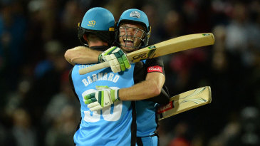 Ben Cox is embraced after the winning boundary