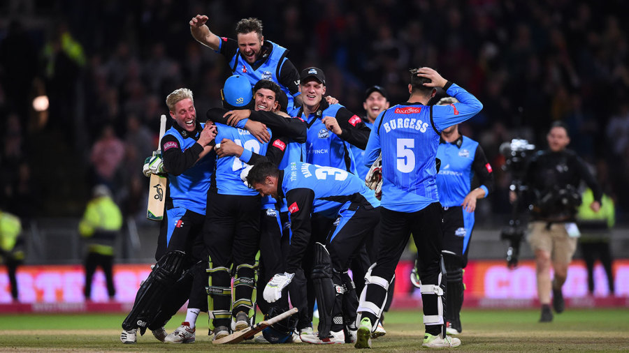 Pile on: Worcestershire celebrate the winning moment