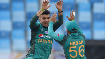 Shadab Khan leaps in celebration after picking up a wicket
