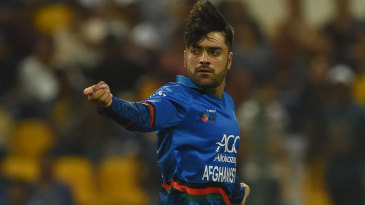 Rashid Khan wheels away in celebration