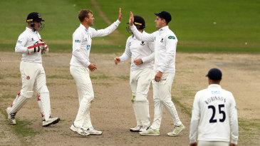 Danny Briggs celebrates a wicket