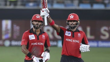 Anshy Rath looks on as Nizakat Khan raises the bat for his fifty