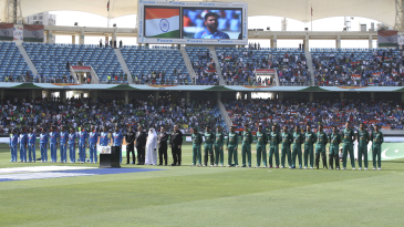 India and Pakistan teams line up for the national anthems