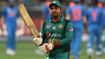 Sarfraz Ahmed walks back after another failure with the bat