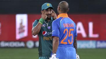 Hasan Ali gestures towards Shikhar Dhawan during the chase