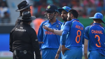 Rohit Sharma seeks clarification from the umpires after a dead-ball call