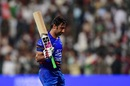 Asghar Afghan raises his bat while walking off, Afghanistan v Pakistan, Super Fours, Asia Cup 2018, Abu Dhabi, Sep 21, 2018