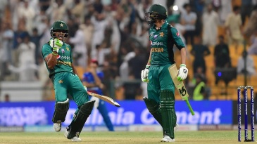 Hasan Ali celebrates with Shoaib Malik after Pakistan's win
