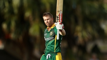 David Warner raises his bat after getting to a hundred