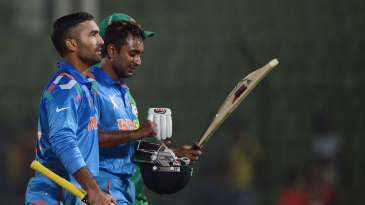 Dinesh Karthik and Ambati Rayudu walk off the field