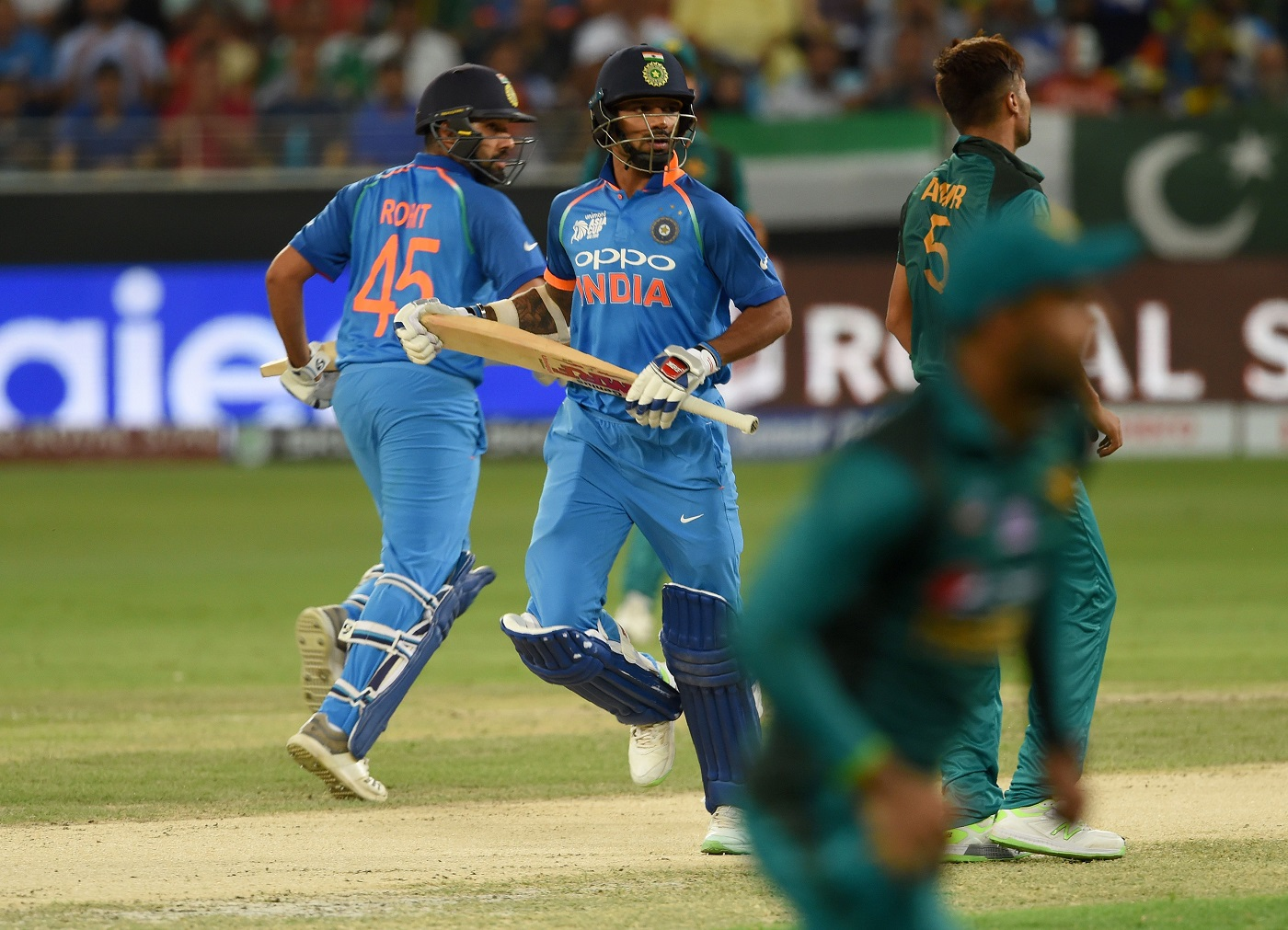 Indian openers destroy Pakistan's bowling as they romp to nine-wicket win in the Asia Cup