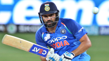 Rohit Sharma guides the ball towards the leg side