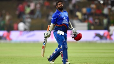 A disappointed Mohammad Shahzad walks back