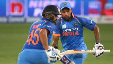 Rohit Sharma and Shikhar Dhawan run between the wickets