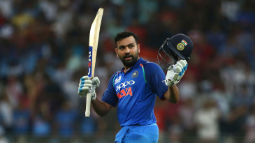 Rohit Sharma raises his bat after getting to his hundred