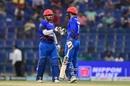 Mohammad Nabi and Samiullah Shenwari punch gloves, Afghanistan v Bangladesh, 4th match, Super Four, Asia Cup 2018, Abu Dhabi, September 23, 2018