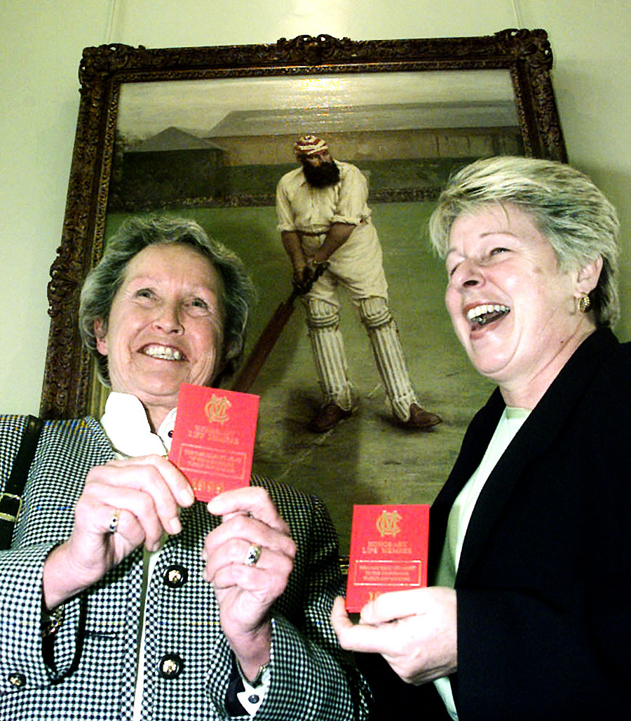 Former England players Rachael Heyhoe-Flint (left) and Jacqueline Court hold up their MCC membership books in 1999