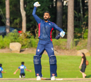 Jaskaran Malhotra drops his bat and salutes his team-mates after scoring his maiden century for USA, USA v Belize, ICC World Twenty20 Americas Sub Regional Qualifier A, Morrisville, September 21, 2018