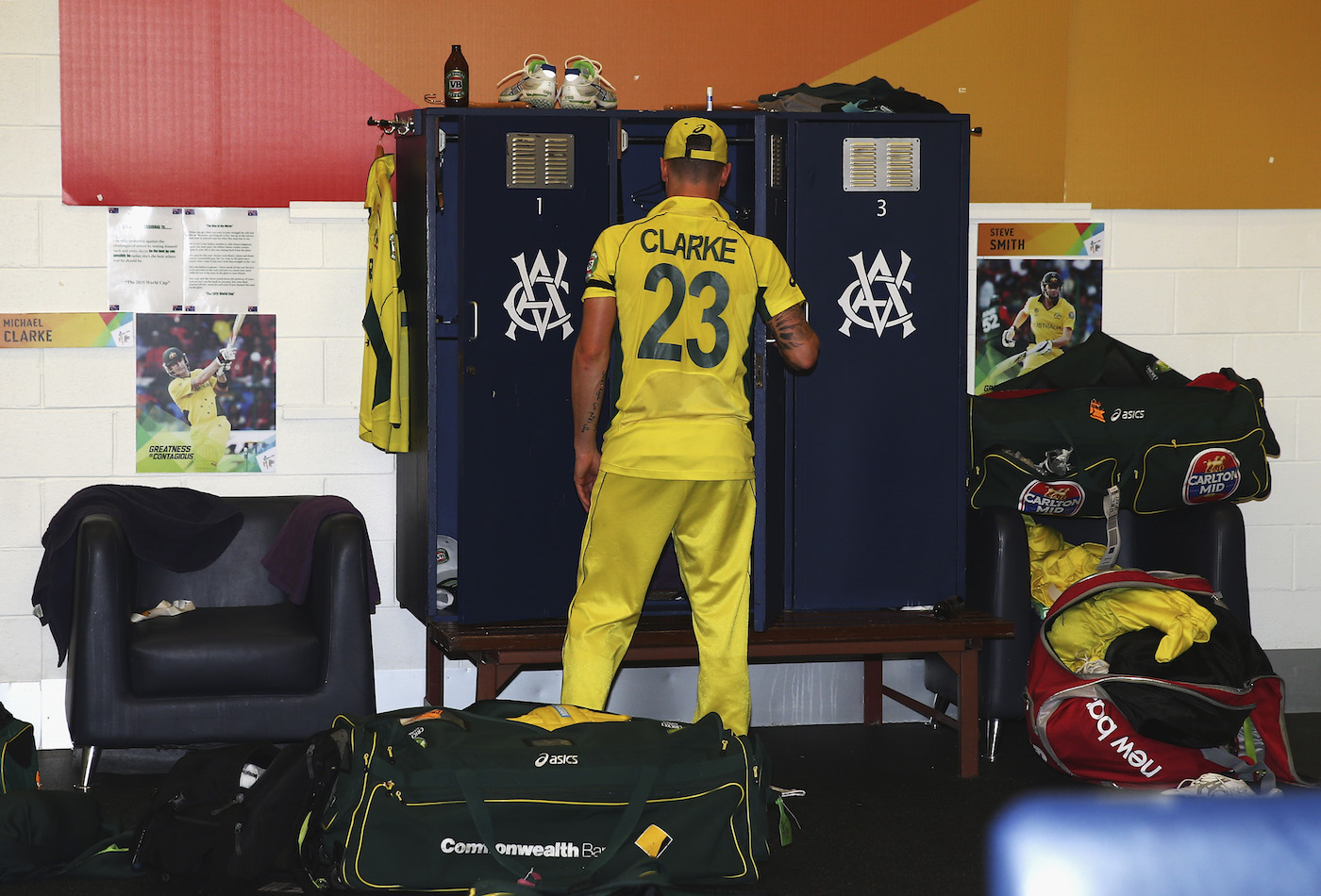Lonely at the top: Clarke packs up after Australia's rout of New Zealand in the 2015 ICC World Cup final