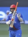 Mohammad Shahzad points to his bat after completing his 14th ODI fifty, Afghanistan v India, Asia Cup 2018, Dubai, September 25, 2018