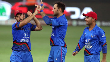 Mohammad Nabi celebrates with his team-mates after breaking a partnership
