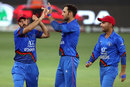 Mohammad Nabi celebrates with his team-mates after breaking a partnership, Afghanistan v India, Asia Cup 2018, Dubai, September 25, 2018