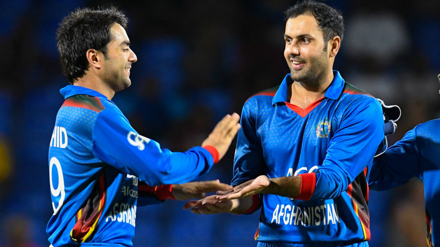 Mohammad Nabi (right) and Mujeeb Ur Rahman's disciplined bowling puts pressure on the batsmen, setting the stage for Rashid Khan (left) to come in and bowl them out