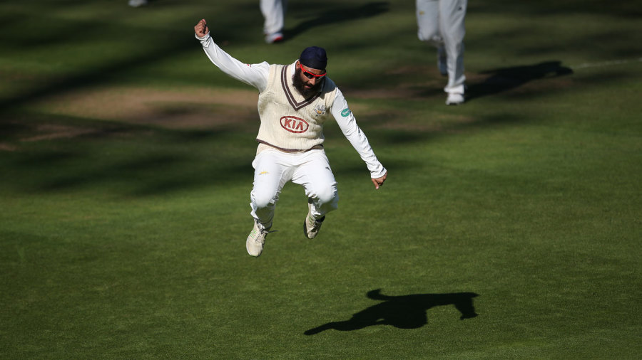 Amar Virdi leaps in jubilation after taking a wicket